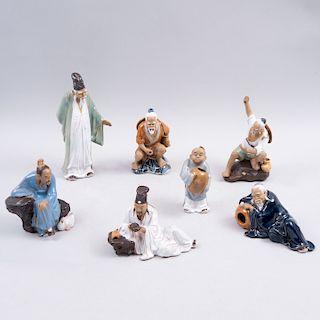 Lote de personajes orientales. China, siglo XX. Elaborados en terracota policromada en acabo brillante. Piezas: 7