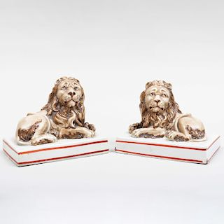 Pair of Wood & Caldwell Staffordshire Pearlware Lions