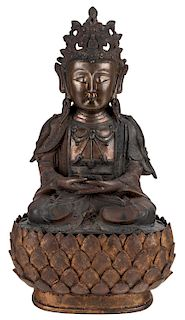 A GILT SINO-TIBETAN BRONZE FIGURE OF A GUANYIN WITH WOODEN BASE, 19TH CENTURY