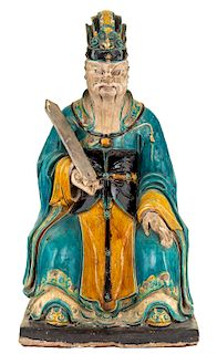 A MONUMENTAL SANCAI-GLAZED FIGURE OF A JUDGE, MING DYNASTY