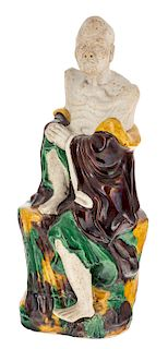 A CHINESE EGG AND SPINACH BISQUE FIGURINE OF AN ARHAT, LATE QING DYNASTY, 18TH-19TH CENTURY