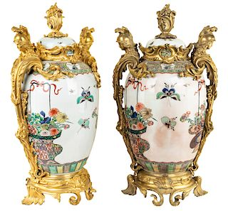 A PAIR OF MONUMENTAL FRENCH ORMOLU-MOUNTED CHINESE FAMILLE VERTE VASES, LIKELY SAMSON & CIE, PARIS