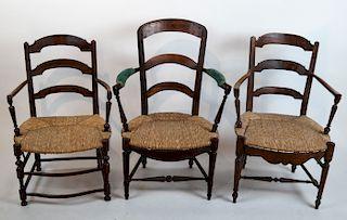 Three Rush Seat Armchairs