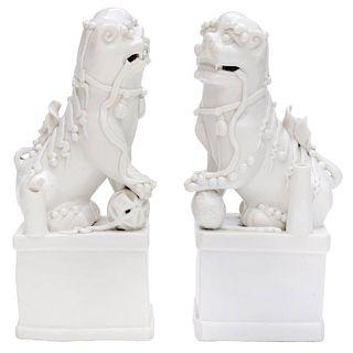 Pair of Blanc de Chine Buddhist Lions, Foo Dogs Early Kangxi, 1662-1722