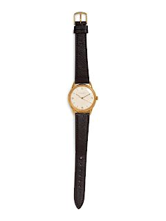 A Men's Yellow Gold Wristwatch, IWC vintage yellow gold round face watch with silver dial and stick and numeral markers.