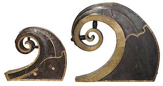 Two Brass Mounted Carved Wood Prow Ornaments