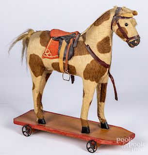 Dappled mohair platform horse pull toy