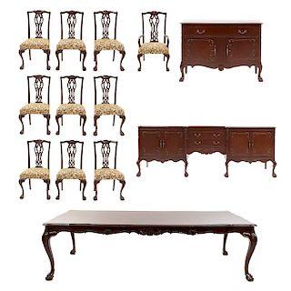 Comedor. SXX. Estilo Chippendale. En talla de madera. Consta de: Mesa, 9 sillas, sillón y 2 trinchadores. 75 x 263 x 120 cm. (mayor)
