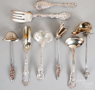 Eight sterling silver serving utensils