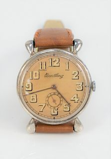 Breitling Mens Vintage Wristwatch, having tan dial and second hand. 35.3 millimeters.