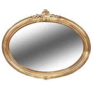 Espejo. Siglo XX. Elaborado en madera estucada y dorada. Con luna oval. Dimensiones: 104 x 130 x 6 cm.