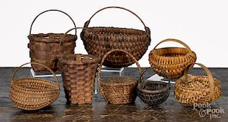 Collection of eight small woven baskets