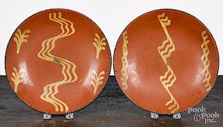 Two Pennsylvania slip decorated redware plates