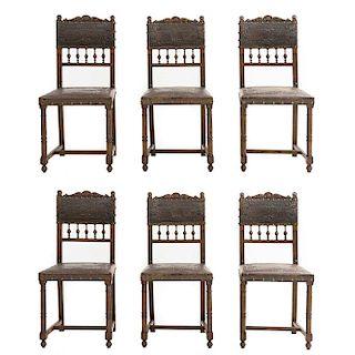 Lote de 6 sillas. Francia. Siglo XX. Estilo Enrique II. En talla de madera de roble. Con respaldos semiabiertos y asientos de tipo piel
