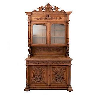 Bufffet. Francia. Siglo XX. Estilo Enrique II. En talla de madera de roble. A 2 cuerpos. Con 2 cajones y 4 puertas. 270 x 140 x 55 cm.