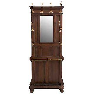 Perchero-paragüero. Francia. SXX. Estilo Enrique II. En madera de nogal. Con 8 ganchos y espejo de luna rectangular. 202 x 79 x 18 cm.