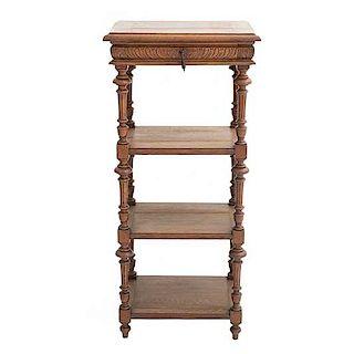 Pedestal. Francia. Siglo XX. En talla de madera de roble. Con cajón con tirador y 3 entrepaños inferiores. 110 x 50 x 40 cm.