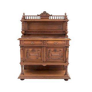 Aparador. Francia. Siglo XX. Estilo Enrique II. En talla de madera de nogal. Con cubierta de mármol rojo japeado. 172 x 127 x 52 cm.