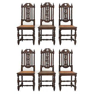 Lote de 6 sillas. Francia. Siglo XX. En talla de madera de roble. Con respaldos semiabiertos y asientos de bejuco.