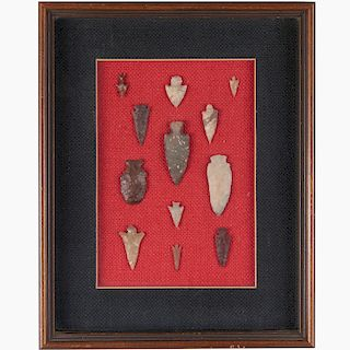 (12) Indian stone projectile points in display
