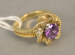 18K gold ring set with round amethyst, size 7. 11.1 grams.