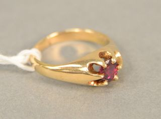 14K gold ring set with ruby. approximately .50 carats.