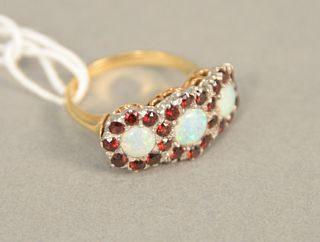 14K gold ring set with three opals each surrounded by red stones, size 6.