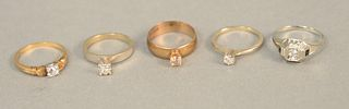 Five diamond rings to include one 18K gold and four 14K gold, each set with small diamonds. total weight 24.4 grams.