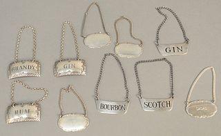 Ten sterling silver liquor tags. 3.6 t.oz.