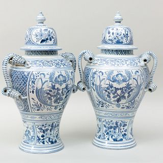 Pair of Delft Style Blue and White Urns and Covers