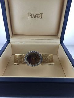 Piaget 18kYG Women's w/YG Bracelet,Diamond bezel,Tiger Eye dial.BNC.Est.$50K