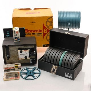 8 MILLIMETER HOME MOVIE PROJECTOR AND REELS