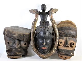 Three Hanging African Face Carvings