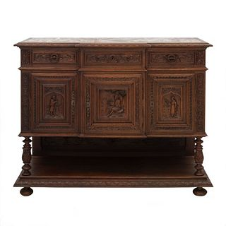 Aparador. Francia. Siglo XX. Estilo Bretón. En talla de madera de roble. Con cubierta rectangular de mármol rojo, 3 cajones.