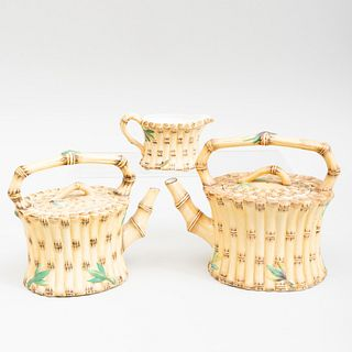 Two Wedgwood Faux Bamboo Porcelain Teapots and a Cream Jug