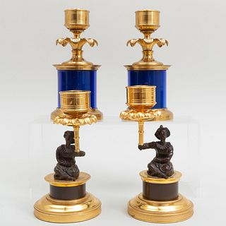 Pair of Chinoiserie Parcel-Gilt Candlesticks and a Pair of Blue Glass and Brass Candlesticks