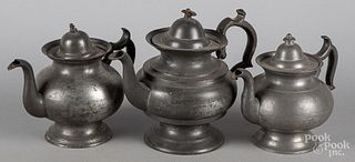 Three American pewter teapots, 19th c.