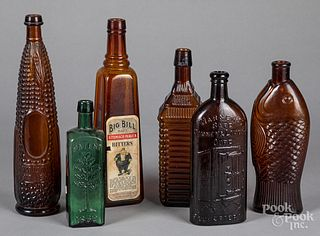 Six glass bitters bottles