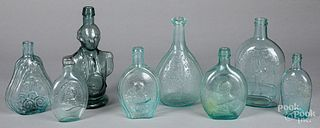 Historical aquamarine glass bottles and flasks