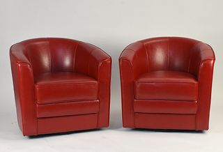 Pair of red leather barrel back club chairs