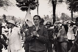 ROBERT CAPA (1913–1954) German soldiers surrender to French Resistance fighters during The Liberation of Paris, 1944