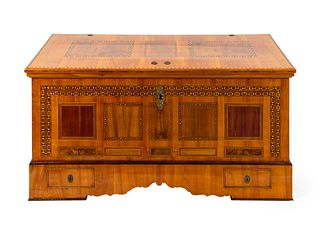 A Continental Parquetry Chest Height 30 x width 58 3/4 x depth 26 inches.
