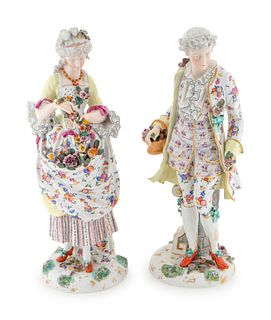 A Pair of German Porcelain Figures Height 19 1/4 inches.