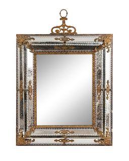 An Italian Gilt Bronze Mounted Mirror Height 41 x width 30 inches.