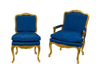 A Set of Fourteen Italian Louis XV Style Giltwood Dining Chairs Height 40 inches.