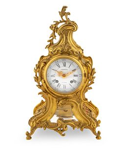 A Lous XV Style Gilt Bronze Mantel Clock Height 15 inches.