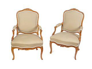 A Pair of Louis XV Style Oak Fauteuils Height 37 inches.