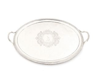 A George III Silver Two-Handled Oval Tray Length over handles 26 1/2 x width 17 inches.