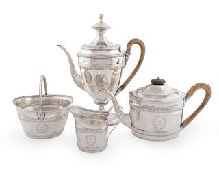 A George III Silver Four-Piece Tea and Coffee Service Height of coffee pot 12 x length over handle 9 7/8 inches.