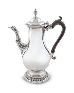 A George III Silver Coffee Pot Height  11 3/8 x length over handle 9 1/4 inches.
